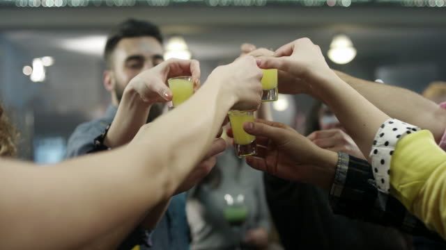 Group of young people dance and drink cocktails video