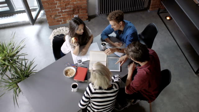 group of young people on the meeting in modern loft apartment/office. - sezione superiore video stock e b–roll