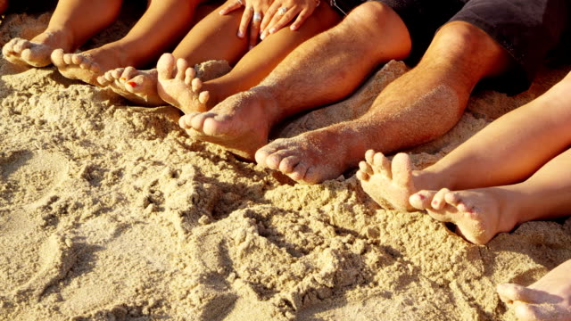 Group of young people with feet in sand, closeup HD 1080p: Group of young people with feet in sand, closeup medium group of people stock videos & royalty-free footage