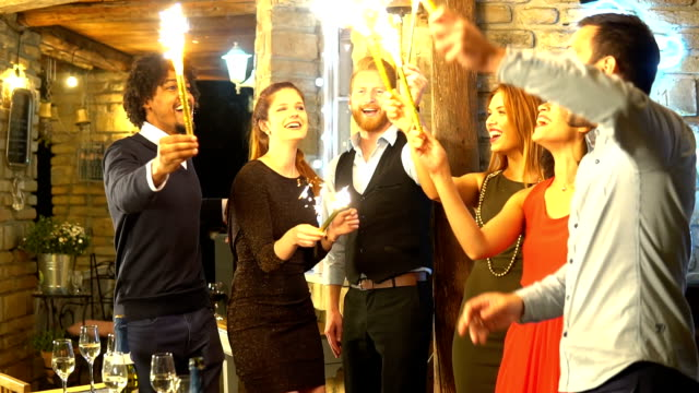 Group of young people with sprinklers Happy young people holding mini fireworks in their hands medium group of people stock videos & royalty-free footage