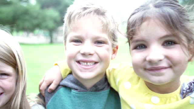 Group Of Young Smiling Young Children Looking Into Camera video