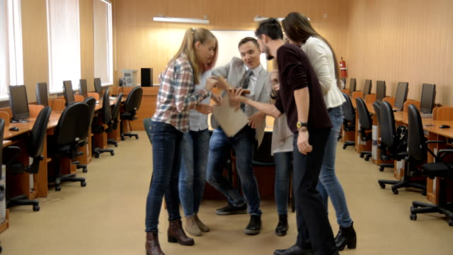 Group of young successful people dancing in a computer room video