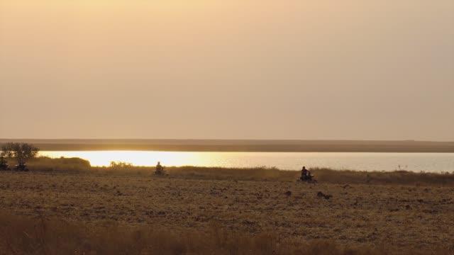 Group on Quad Bike Rides through the Desert. Driving ATVs.