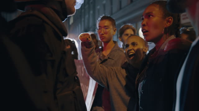 group protesting against police violence - violenza sulle donne video stock e b–roll