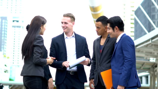 group young business workers communicate and planing new start up business project at  outside - coinvolgimento dei dipendenti video stock e b–roll