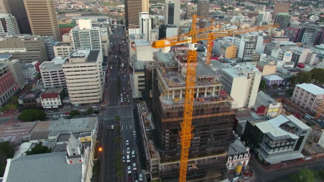 Growing a city building by building Aerial drone footage of Cape Town, South Africa western cape province stock videos & royalty-free footage