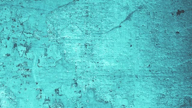 vídeos de stock e filmes b-roll de 4k grunge noise random blue wall texture background in stop motion - azul turquesa