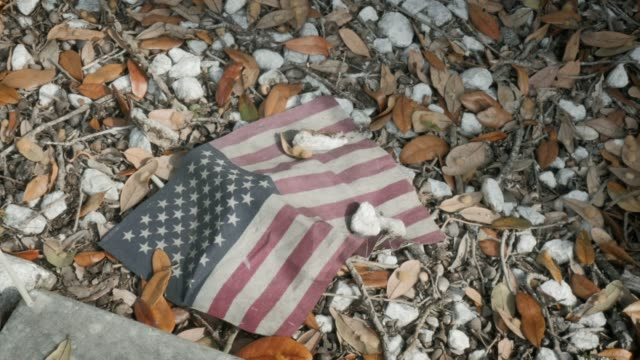 Grungy American Flag on the Ground Symbolic of Devolving American Value System video