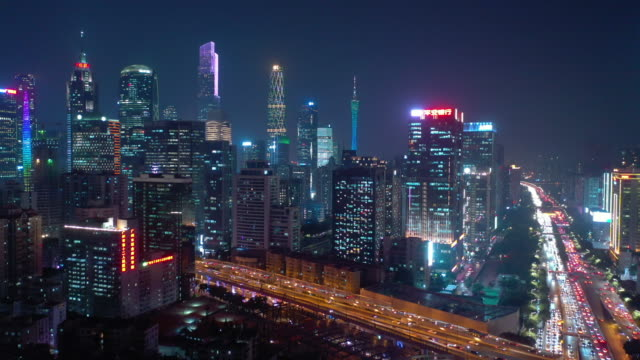 guangzhou city downtown night illuminated busy traffic street road intersection aerial panorama 4k china video