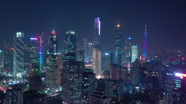 guangzhou city downtown night time busy traffic street road junction aerial topdown panorama 4k china video
