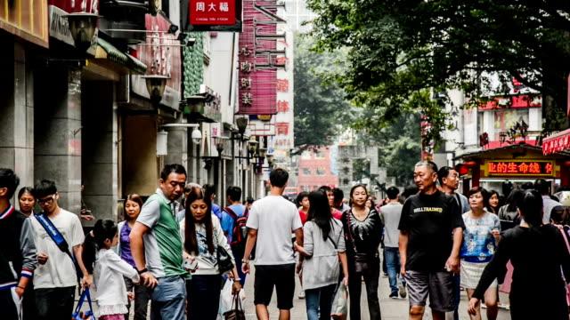 Guangzhou,China-Nov 29,2014: People roam the famous shopping street-Beijing Road in Guangzhou, China People roam the famous shopping street-Beijing Road in Guangzhou, China china east asia stock videos & royalty-free footage
