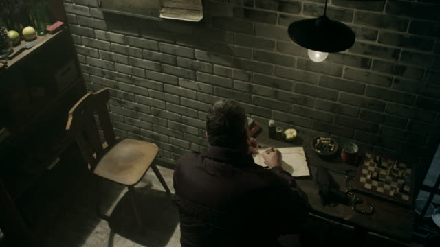 Guard writing down information about convicts in prison video