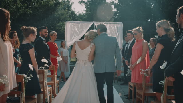 guests looking at bride and father walking on aisle - matrimonio video stock e b–roll