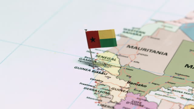 Guinea Bissau with National Flag tracking to Guinea Bissau with National Flag ziguinchor stock videos & royalty-free footage