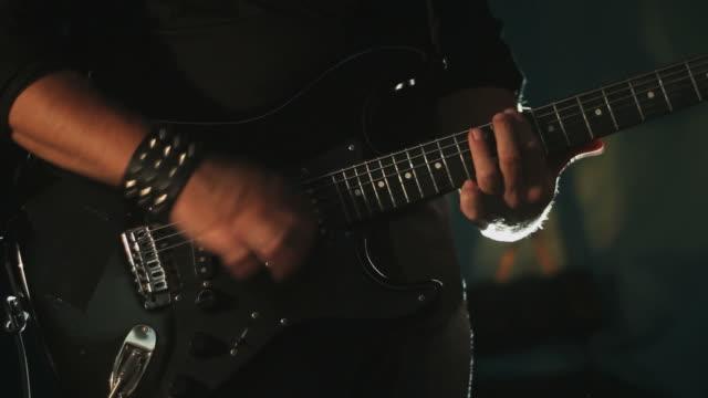 guitar performance with light effects, closeup - gitarrist bildbanksvideor och videomaterial från bakom kulisserna