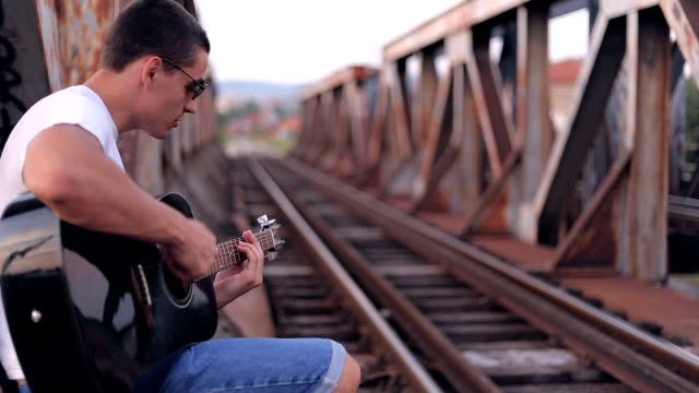 guitar player on old bridge - musicians singers during lockdown video stock e b–roll