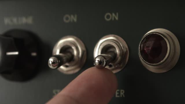 guitar player powering on tube valve vintage amplifier - głośnik filmów i materiałów b-roll