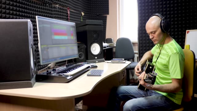 Guitar Player Records Sound Of Instrument In Studio
