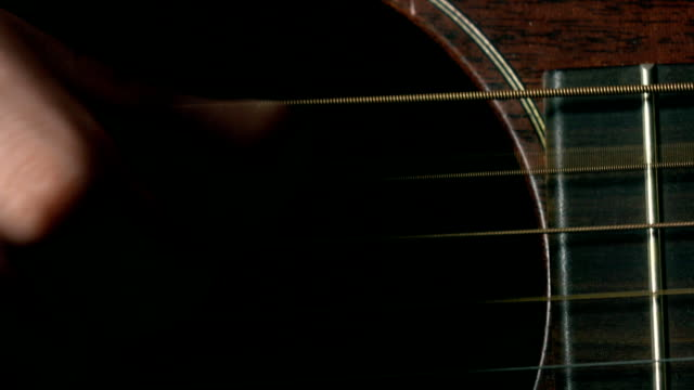 Guitar player's hand over strings. Music performance. FullHD macro video video
