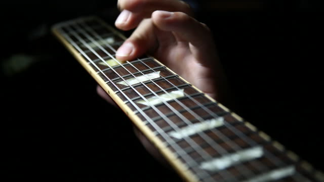 Guitar player's hands playing guitar scales video