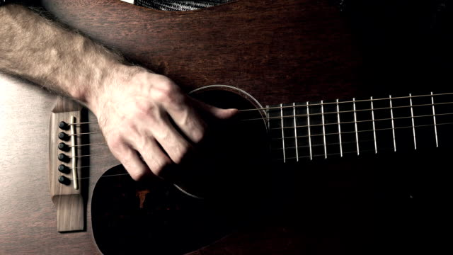 Guitarist hand touching guitar strings. Music performance. FullHD video video
