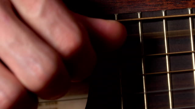Guitarist hand touching strings. FullHD macro video video