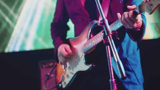 Guitarist playing guitar Band making music on concert stage arts culture and entertainment stock videos & royalty-free footage