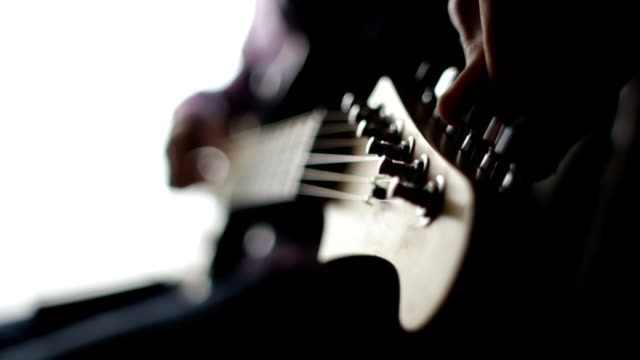 Guitarist sets up the electric guitar before the concert video