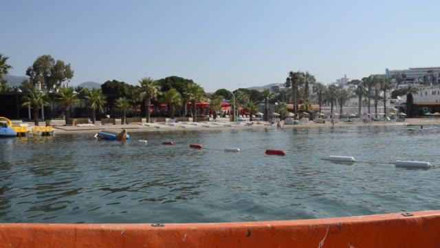 gumbet, bodrum aegean sea bay and beach panorama - morze egejskie filmów i materiałów b-roll