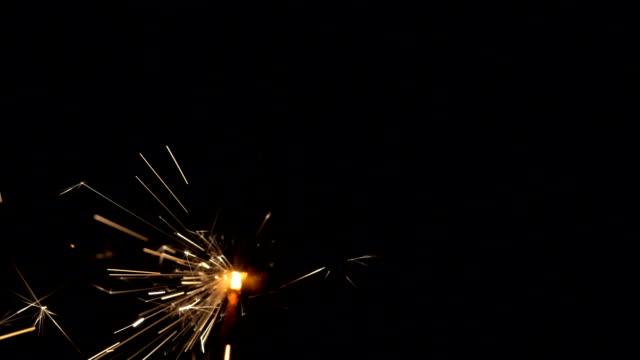 Gun powder sparks shot against deep dark background video
