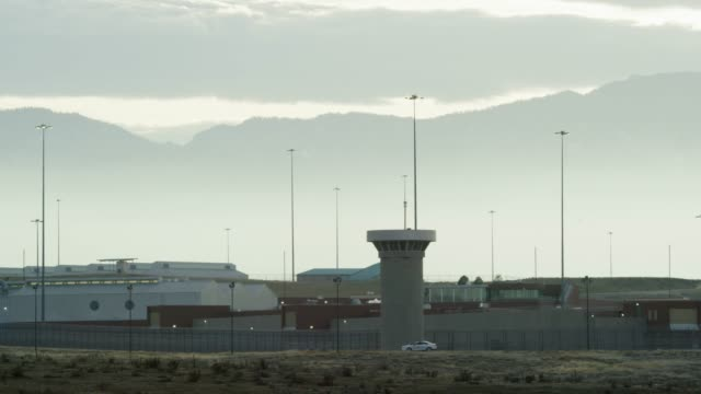 Gun Towers and the Exterior of the United States Penitentiary, Administrative Maximum Facility Supermax Prison Complex in Florence, Colorado (Fremont County) under the Rocky Mountains - the