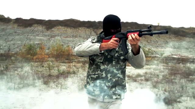 Gunman Terrorist Assassin Walking Through Smoke video
