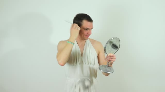 guy combing his hair the guy combs his hair, looks in the mirror he holds actor stock videos & royalty-free footage