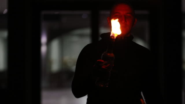 guy flair bartending with flamed bottles at night - vodka video stock e b–roll