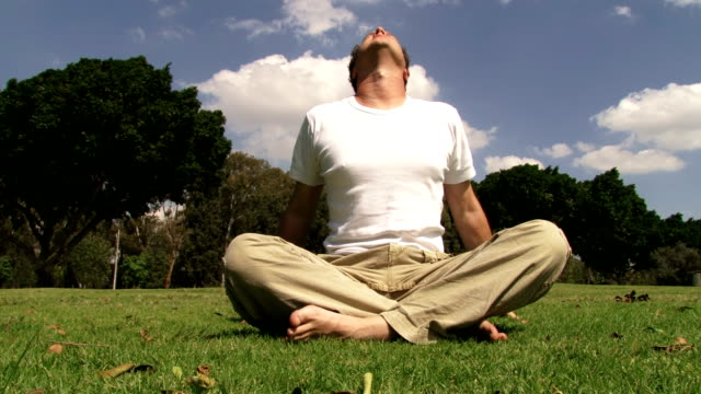 Guy meditating and contemplating video