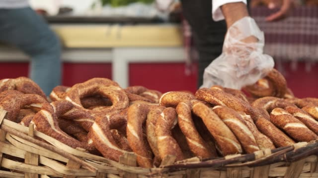 A Guy Selling Simit In The Street