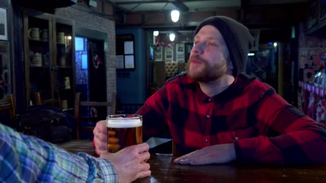 Guy watching game at the pub video