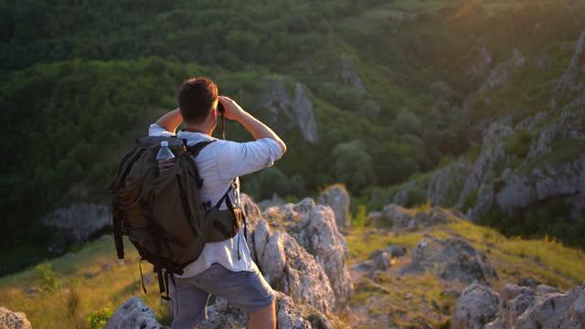 A guy watching through binoculars