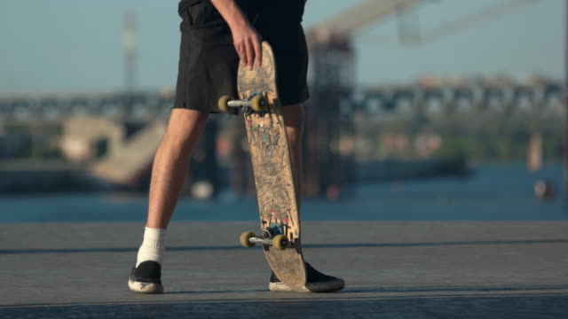 Guy with skateboard outdoor. video
