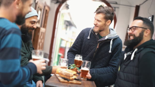 guys having beer at a pub. - baffo peluria del viso video stock e b–roll