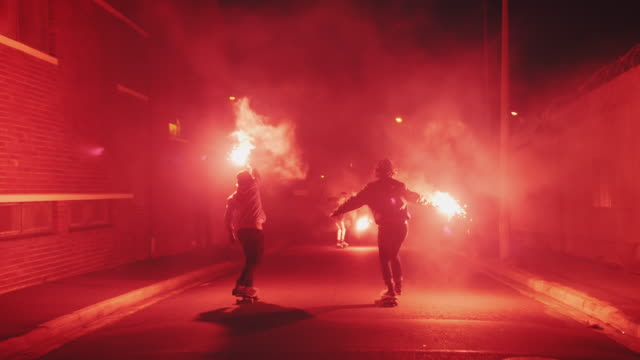 guys skateboarding with torches on a street - skateboard stock videos & royalty-free footage