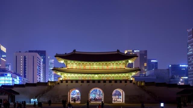 Gwanghwamun Gate at night, Seoul, South Korea, HD Time lapse Gwanghwamun Gate at night, Seoul, South Korea, HD Time lapse gyeongbokgung stock videos & royalty-free footage