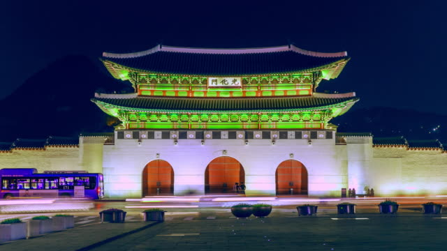 Gyeongbokgung palace front view with road traffic at twilight Gyeongbokgung palace at night Timelapse, South Korea gwanghwamun gate stock videos & royalty-free footage