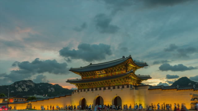 Gyeongbokgung Palace of during Sunset Gyeongbokgung Palace of during Sunset in South Korea, with the name of the palace (Gyeongbokgung' on a sign) gyeongbokgung stock videos & royalty-free footage