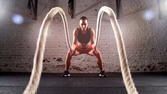 gym battling ropes at gym workout exercise. Slow motion video