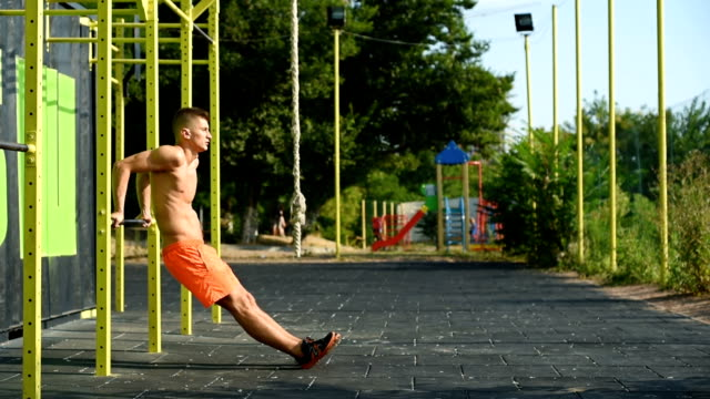 gym Man Doing An Exercise. Close Up Muscular gym Man Doing An Exercise. Close Up bodyweight training stock videos & royalty-free footage