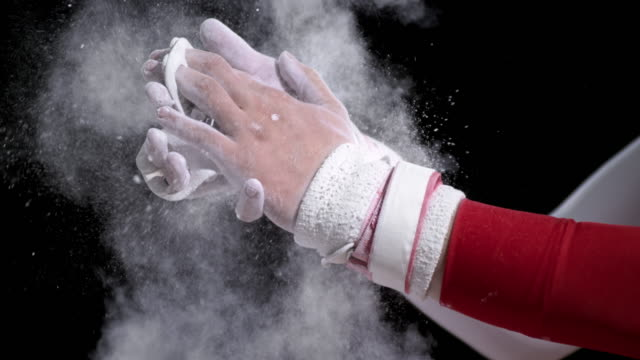 SLO MO Gymnast clapping wrapped chalky hands together video
