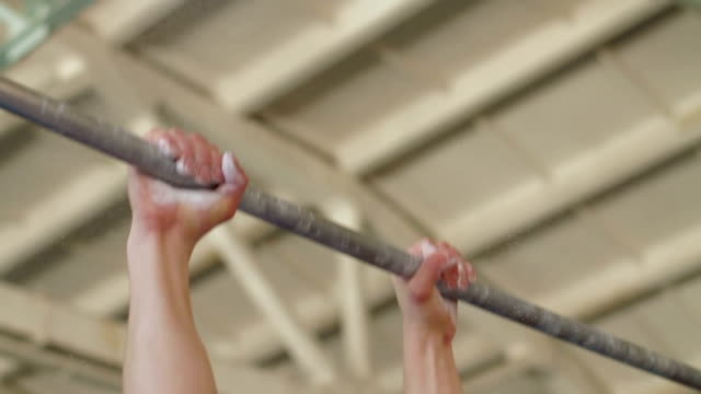 Gymnast hand on horizontal bar Slow motion video