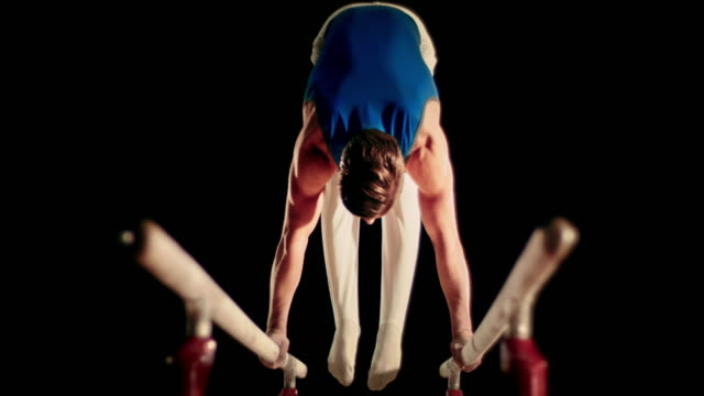 SLO MO Gymnast moving from L-sit position video