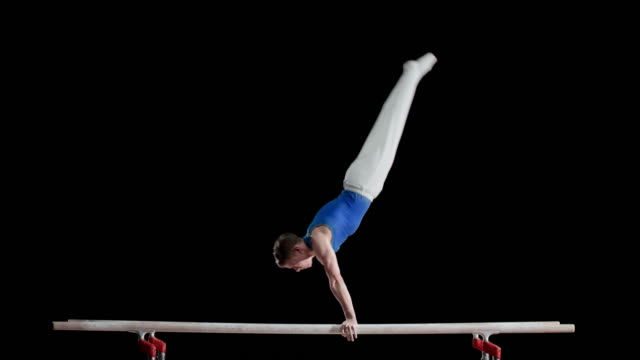 LD Gymnast performing on parallel bars